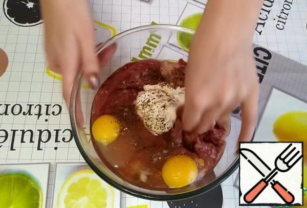 Add sour cream, 2-3 eggs, brandy, salt to taste, ground black pepper. Mix everything well.