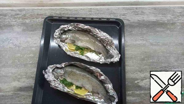 We lay the trout on the foil
