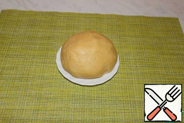 Knead the soft dough. The dough does not stick to your hands. Transfer the dough to a bag and put it in the refrigerator for 30-60 minutes.
