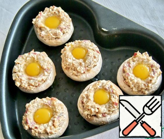 Beat a quail yolk into the center of each mushroom. Bake at 180* 10 minutes. Decorate to your liking.