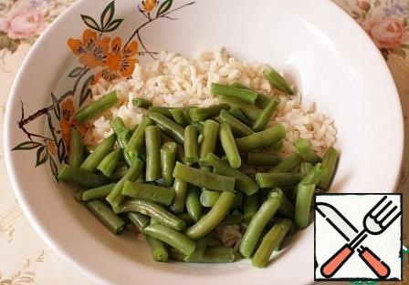 Add the string beans to the rice. The amount of beans can be varied to taste.
