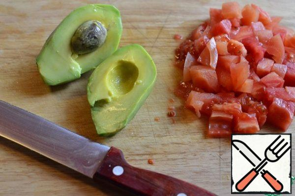Chop the avocado and tomato.
