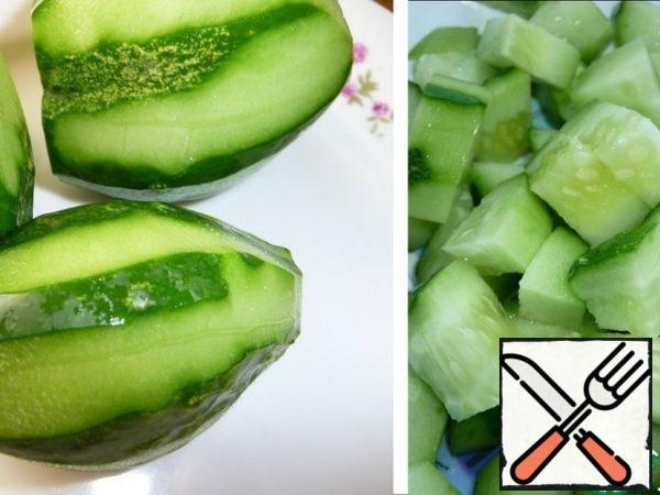 Cucumbers are peeled and coarsely chopped.