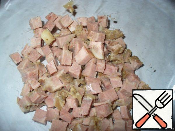 Cut the pork into cubes.