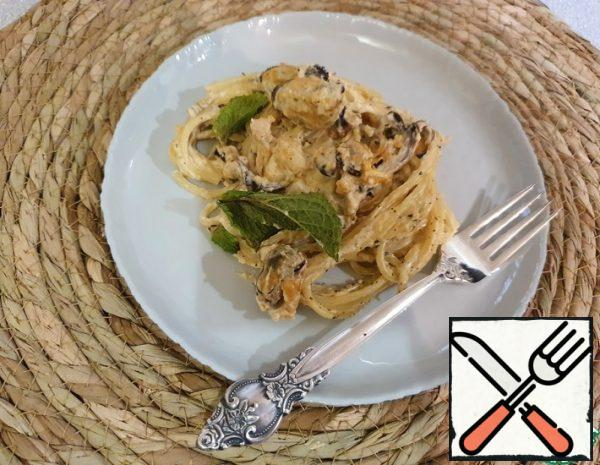1. Boil the spaghetti. 2. Pour a little olive oil into a frying pan and spread the seafood. Fry for 5 minutes, stirring. 3. Add the chopped garlic. Continue to cook for another 5 minutes, stirring. 3. Add the cream and mix. Add spices ( salt, ground pepper, basil ) to taste. Mix it up.