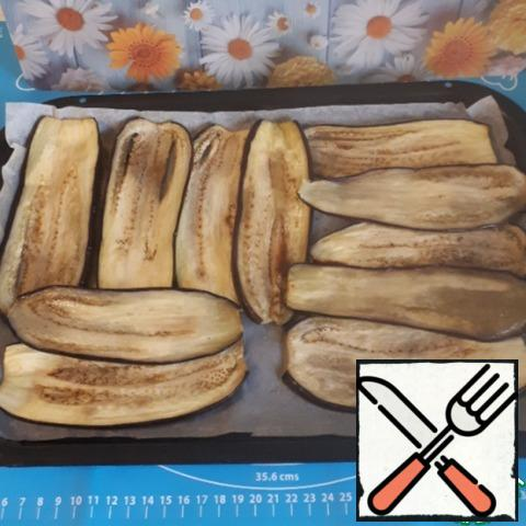 I like the method of baking eggplants in the oven more than frying them in a frying pan, since this way the eggplants are not greasy.