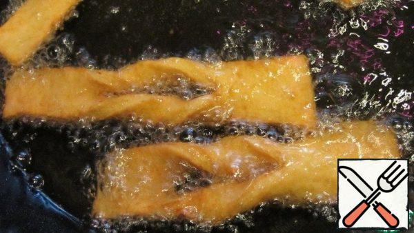Fry until golden brown on both sides.