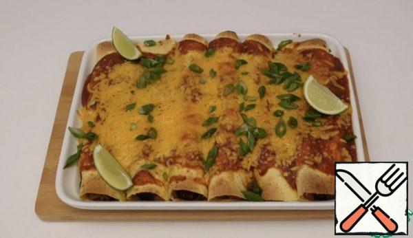 Sprinkle with green onions just right more sour cream will do We brew tea or pour tequila and enjoy your meal
