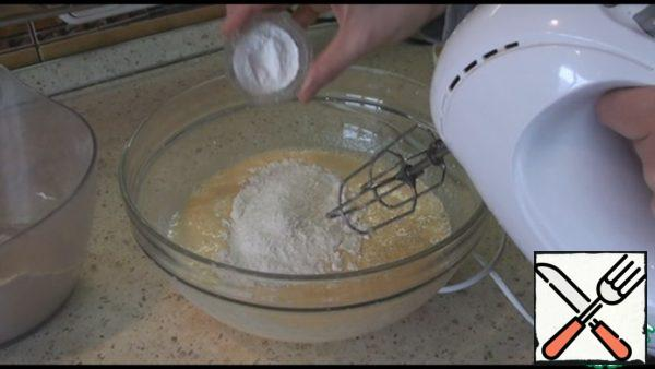 Add flour in two sets and baking powder, stir well.
