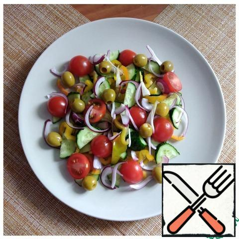We put the chopped cucumber, pepper, cherry and red onion in a plate randomly, but beautifully. Add the olives. I have it with anchovies.