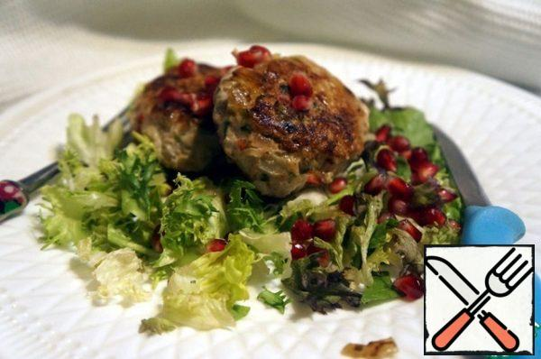 Serve on a pillow of salad mix, garnished with pomegranate seeds. Bon Appetit!