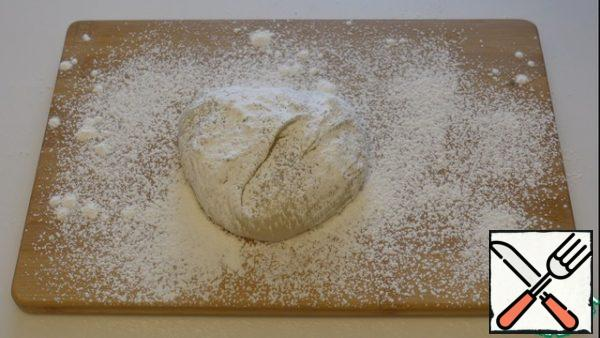 Since the dough is very sticky, we sprinkle cornstarch on the board, along the bottom of the dough, too.