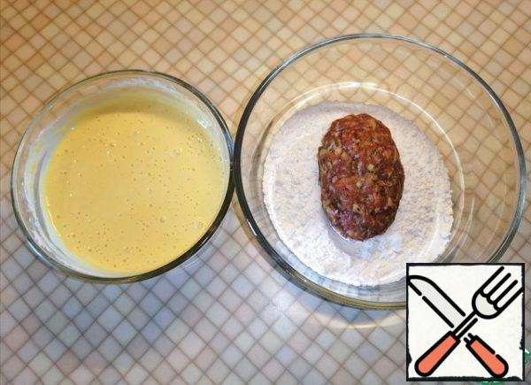 Roll the cutlets in flour and dip them in batter.