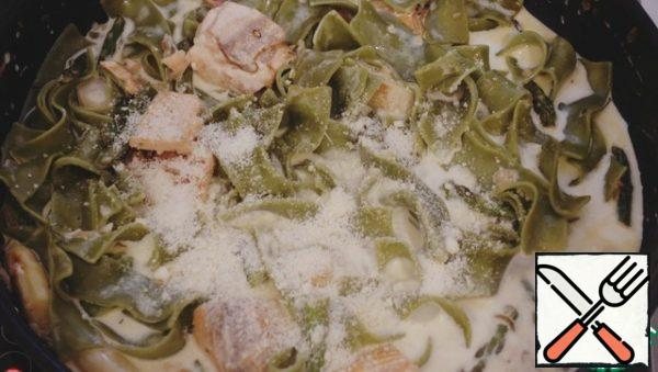 Pour the cream, add the parmesan, and simmer until slightly thick