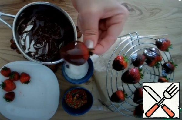 Each strawberry is alternately dipped in chocolate then in coconut shavings or sprinkles