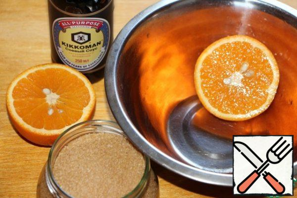 Squeeze the juice from 1 large orange.