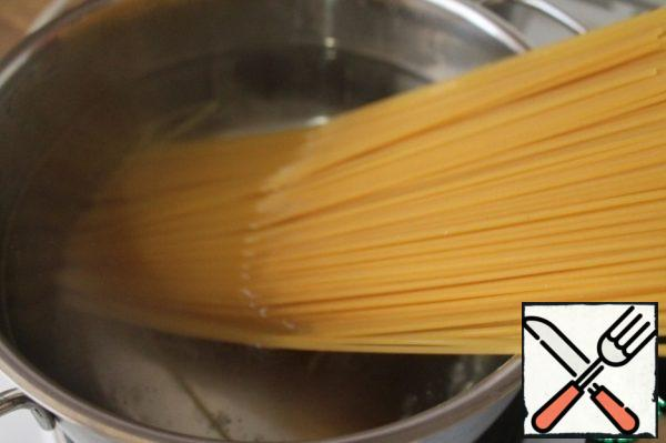 Boil the pasta in boiling salted water until ready.