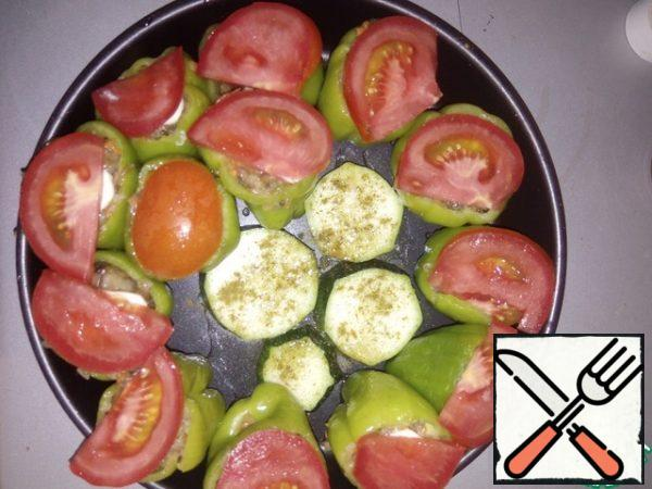 Cut the tomato into slices and spread on top. Bake at 180-200 degrees for about 30 minutes.