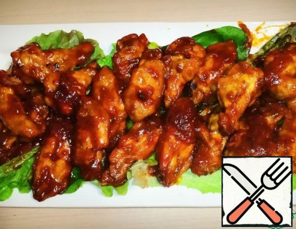 This is one of my favorite chicken wing dishes. It turns out very juicy and delicious. The dish is prepared very quickly and simply. In the recipe, I tried to clearly show how to cook this yummy food. Cooking instructions: 1. Cut the chicken wings into 3 pieces 2. Marinate the wings in a sauce of salt, sunflower oil, soy sauce, a mixture of peppers, paprika, ground pepper and garlic. 3. Leave the wings to stand for 10-15 minutes 4. Spread the wings on a baking sheet and put them in the oven for 30-35 minutes