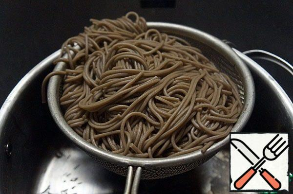 Toss the noodles in a colander.