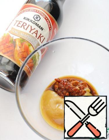 For the marinade, mix the teriyaki sauce , mustard, ajika, butter and sugar.