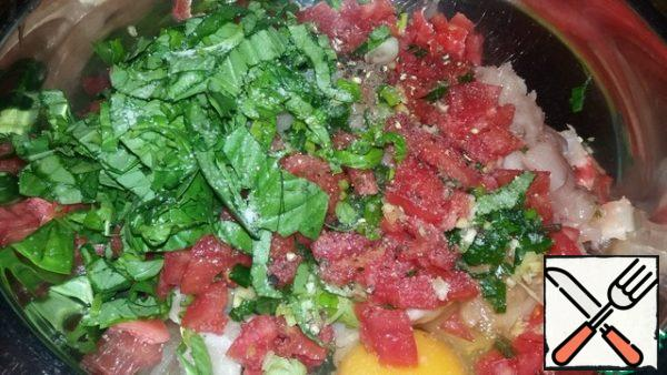 Finely chop the tomato and basil.