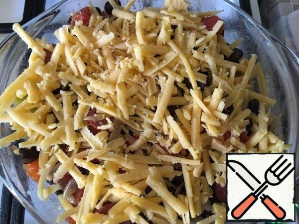 Pour the beans and vegetables into a suitable baking dish. Sprinkle with grated hard cheese. Place in a hot oven (180-190°C) until the cheese melts. For about 10 minutes.