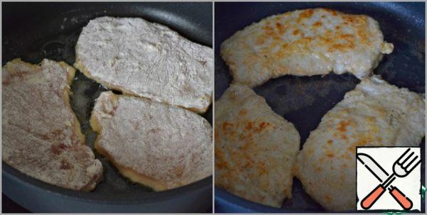 Fry the fillets in well-heated vegetable oil over high heat on both sides until browned (1.5-2 minutes on each side, no more). Place the fried fillets on a paper towel.