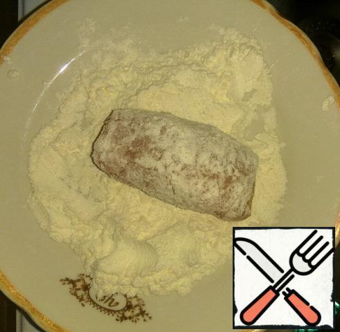 Roll in flour.