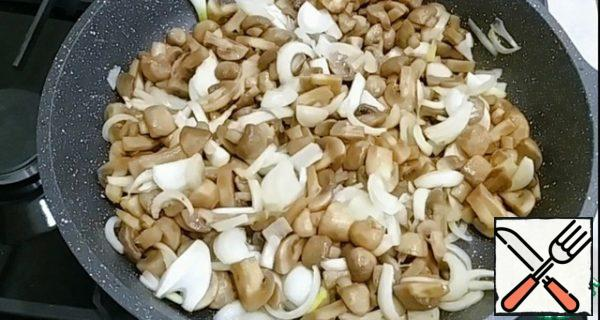 Add the onion and stir. Fry the mushrooms and onions until golden brown.