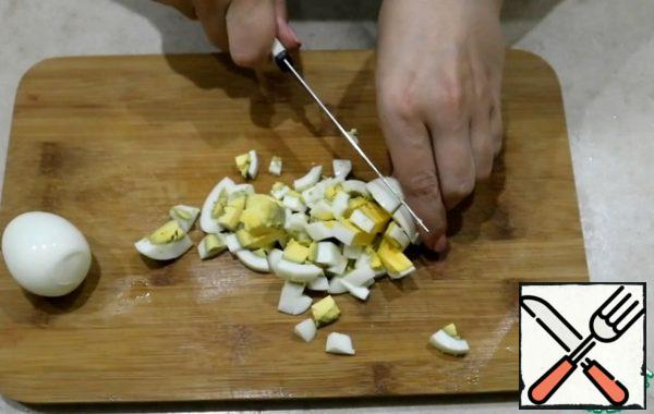 Boil the eggs (I cook them for 10 minutes) and cut into cubes.