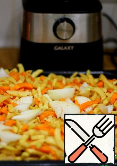 Cut the onion into 8 pieces and mix everything on a baking sheet. Put in a preheated 180 gr. oven for 20-30 minutes without watering anything. When the vegetables are almost ready, you need to sprinkle them with salt (spices if desired). Stir, drizzle with oil, and mix again. Bake until tender.