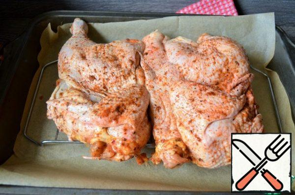 Turn on the oven to warm up. Put the chicken on the grill, on a covered baking sheet.