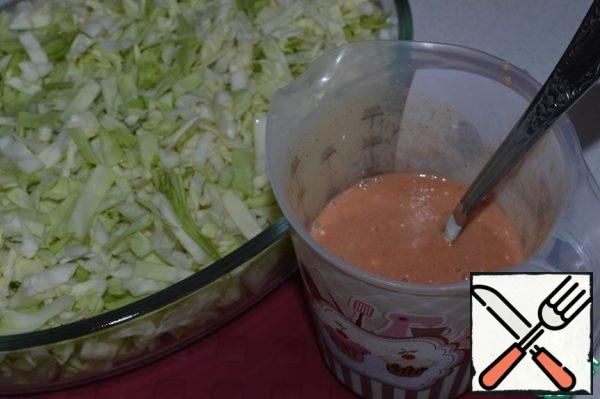 Mix water, tomato paste, yogurt, salt, sugar, pepper and paprika. Pour this mixture over the cabbage.