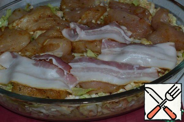 Put the seasoned chicken on the cabbage, and a strip of bacon on each piece of chicken. Bake for about 40-45 minutes. at t=200 * s. Serve with new potatoes and dill.