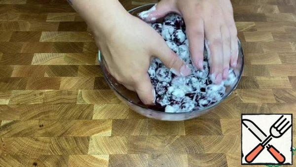 Roll the cherries in flour.