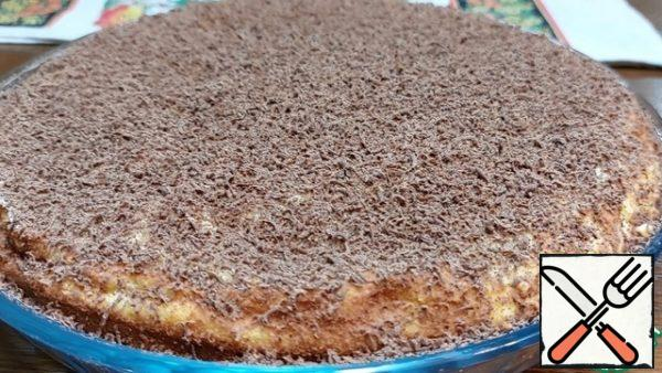 """Carefully remove the parchment paper and sprinkle the cake liberally with grated chocolate. Cottage cheese pie """"on the contrary"""" is ready! Bon Appetit!"""