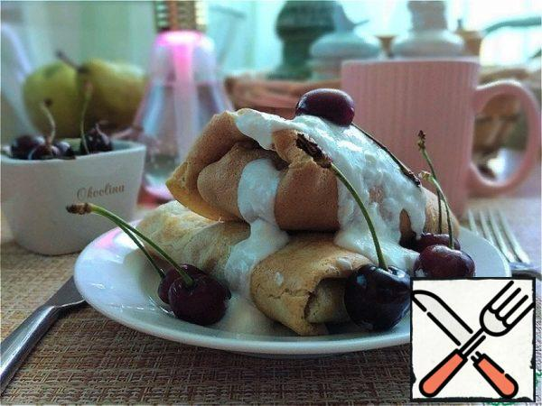 I served it for breakfast, watering the yogurt and adding 5 pieces of cherries.Today, according to the diet menu offered to me for breakfast, I will: Pancakes with cottage cheese-250 g (cooking pancakes at your discretion) Yogurt - 2-3 tbsp Tea or chicory (without sugar)