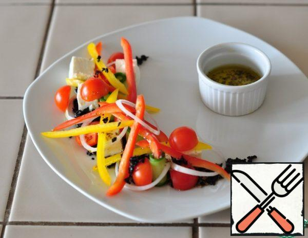 """First you need to prepare a salad dressing-mix olive oil, salt, pepper and oregano. Cut the cheese into cubes, cut the cucumber into thin plates, red onion into thin rings, bulgarian pepper into strips, cherry tomatoes cut in half. Dried olives must be crushed so that they look like """"earth""""."""