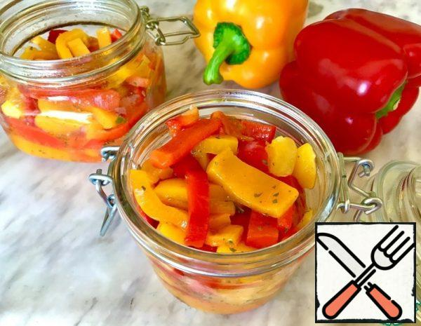 Bake the peppers in the oven (temperature 200C, baking time 25-30 minutes). Put the hot peppers in a plastic bag. Tie the bag and leave the peppers for another half an hour. Now the pepper is easy to clean. Remove the seeds and skin, cut the pulp into pieces of the desired size.