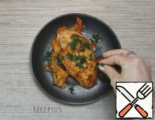 I carefully remove the finished fillet from the oven . Baked chicken breast is served hot to the table, it is easily cut into portions. I usually decorate the chicken with chopped dill .