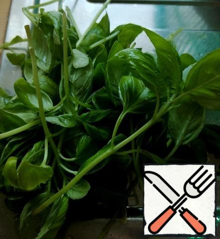 We will need fresh basil, with leaves and stems.
