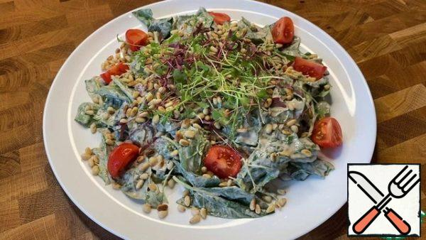 Add the dressing to the salad and mix. Put the salad on a serving dish, decorate with micro-greenery, pine nuts and cherry tomatoes.