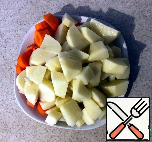 Peel the carrots and potatoes.