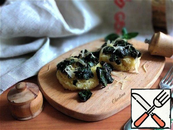 Serve immediately, putting hot polenta on a plate and fried chard on top. Sprinkle With Parmesan.