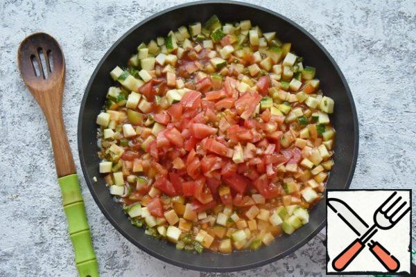Cut the tomatoes into cubes and add them to the vegetables. Stir the tomato paste in 0.5 cups of water and pour it into the vegetable stew. Add salt, pepper, and spices to taste (paprika, basil, thyme, oregano).