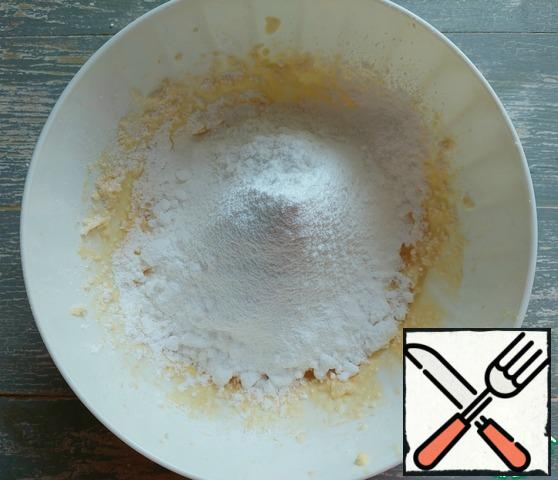 Next, sift the corn starch, powdered sugar and vanilla.
