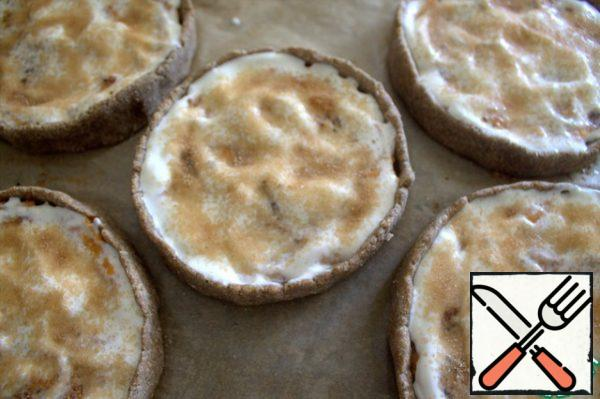 Top with sugar and cinnamon and put it back in the oven until it is browned.