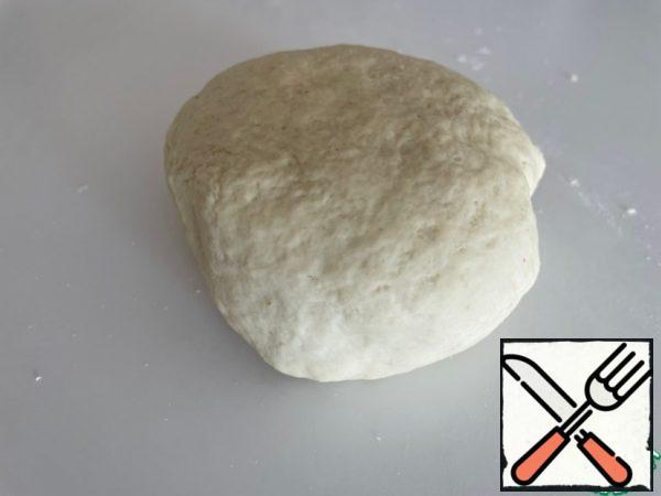 """Add salt, butter and flour carefully in parts. Adding flour, we look at the consistency of the dough, as soon as it stops sticking to your hands - there is enough flour. You should get an """"earlobe"""". Cover the dough and leave it to approach. After 30 minutes, we grind it and let it come up again."""