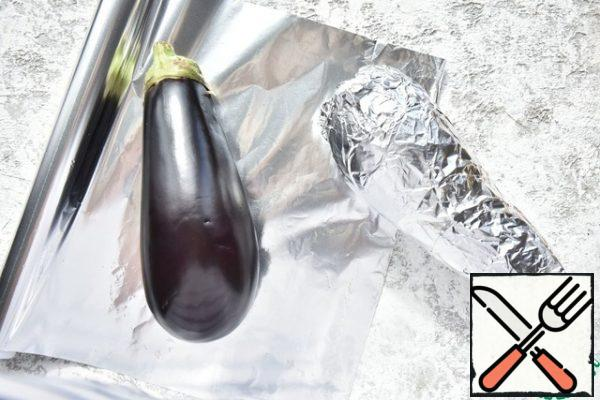 Wash the eggplants and wrap them in foil. Bake in the oven, preheated to 180 degrees until ready.